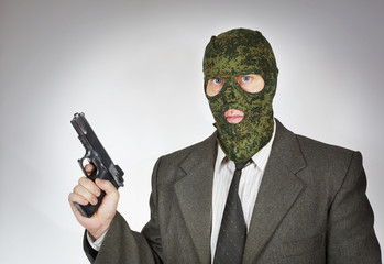 Man wearing mask with a gun