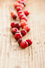 Ripe cranberries on wooden background