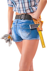 Beautiful female worker with tools in back pocket on shorts on a