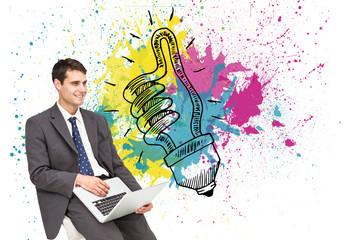 Composite image of businessman using laptop