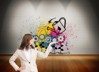 Composite image of smiling businesswoman raising her hand