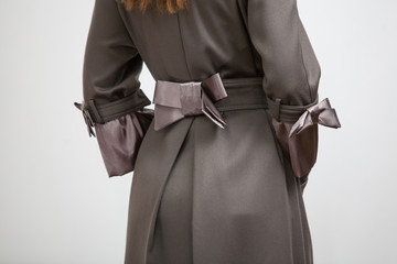 Photo of back of the women coat with silk bow
