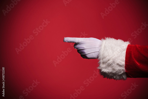 Santa Claus gloved hand pointing finger