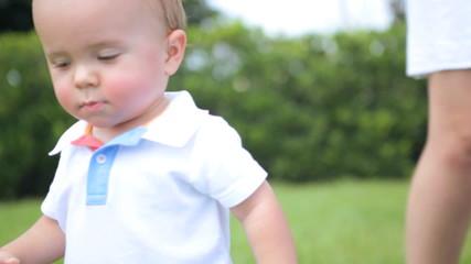 Little Caucasian Boy Toddler Barefoot Outdoors Grass Ball Close Up