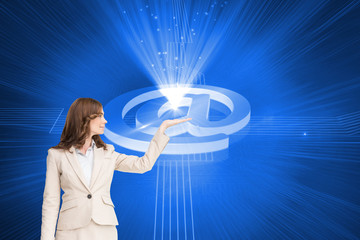 Composite image of businesswoman with empty hand open