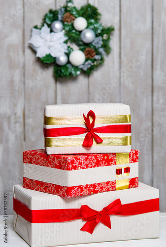 Wrapped gift boxes and Christmas wreath