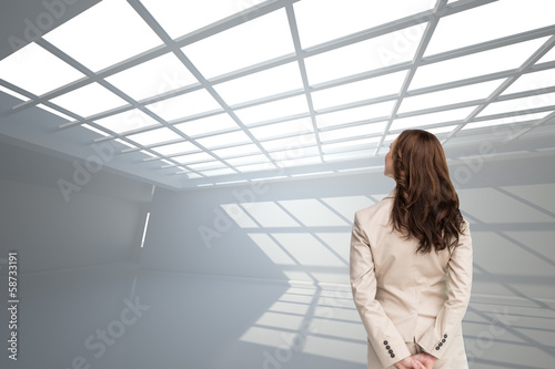 Composite image of rear view of businesswoman