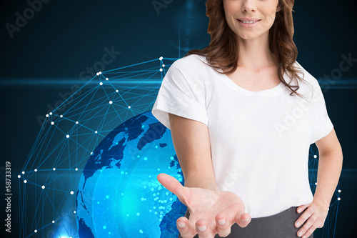 Composite image of attractive brunette presenting her hand