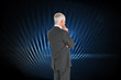 Composite image of thoughtful businessman standing back to camer
