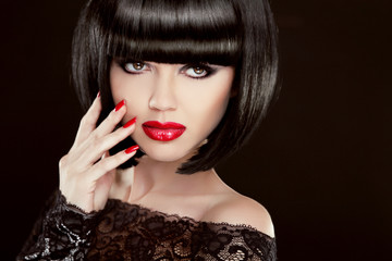 Beauty Portrait. Sexy brunette woman with short hair, red lips,