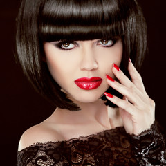 Portrait of Sexy brunette woman with short black hair, red lips,