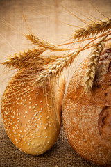 assortment of baked bread on burlap background