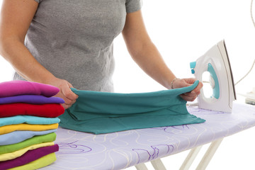 housewife is doing the ironing in closeup over white background