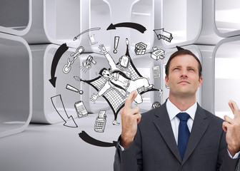 Composite image of serious businessman with fingers crossed is l