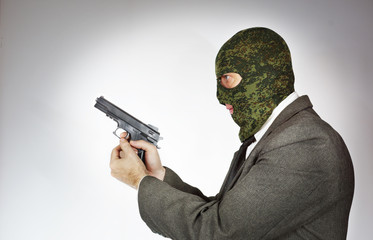 Killer wearing mask with a gun