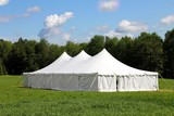 wedding or events tent in green grass field
