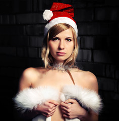 Young woman wearing a Santa Claus hat