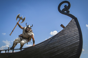 Strong Viking jumping from his ship to attack