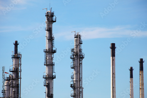 Distillation Towers and Smokestacks on Blue Sky Background