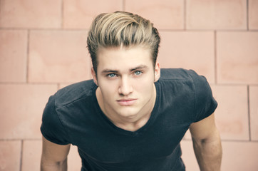 Attractive blond young man shot from above, looking up
