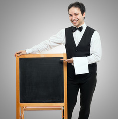 Waiter showing a blackboard