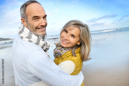 Portrait of loving senior couple at the beach - 58746117