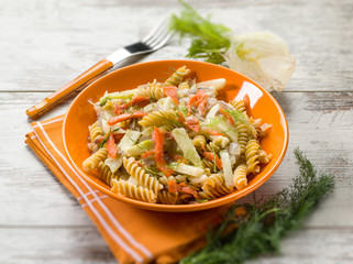 fusilli with smoked salmon and raw fennel, selective focus