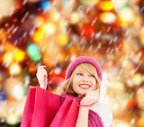 Fototapety woman in pink hat and scarf with shopping bags