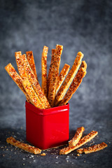Breadsticks in metal container, selective focus
