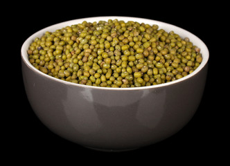 mung beans in gray bowl isolated on black