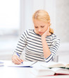 concentrated woman studying in college