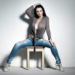 Sexy woman sitting on stool