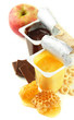 Tasty dessert in open plastic cup and honey combs, fruit,
