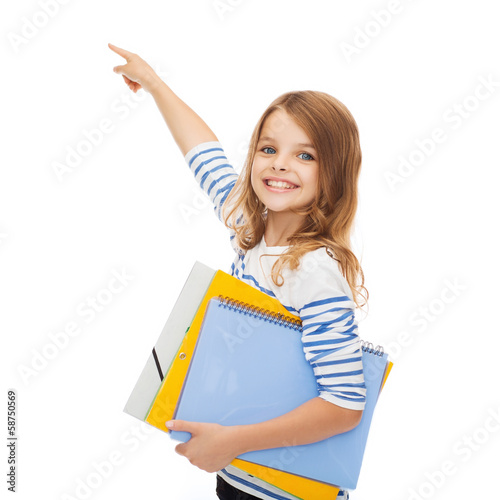 cute girl with folders pointing at virtual screen