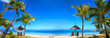canvas print picture - Tropical beach panorama with chairs and umbrellas