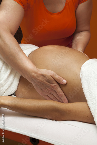 Young pregnant woman receiving relaxing massage