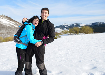 Couple having fun on winter hiking trip