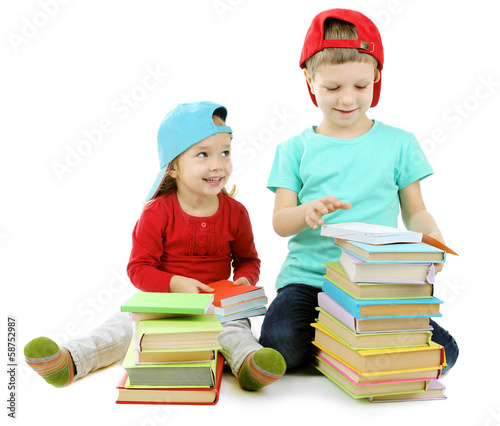 Little children with books isolated on white