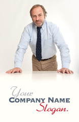 Serious businessman leaning on a table