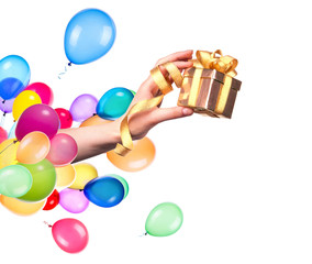 hand with a gift and balloons