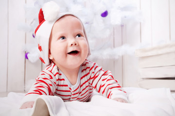 Smiling baby with the Christmas decorations