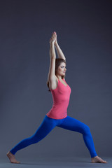 Image of pretty yoga instructor posing in asana