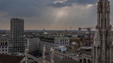 Italy, Milan skyline with sun rays time lapse