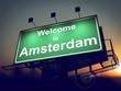 Billboard Welcome to Amsterdam at Sunrise.