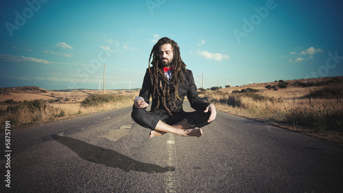 Stylish elegant dreadlocks businessman levitating