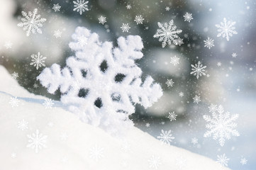 big snowflake toy in snowdrift
