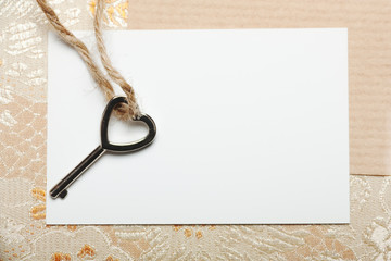 Heart shaped key on a white card.