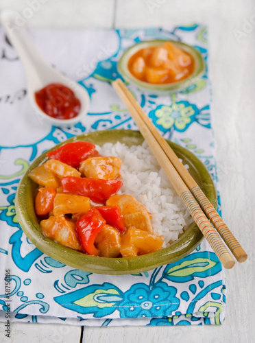 Chicken with pineapple on the wood background