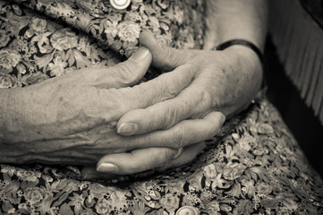 old woman's hands joined together