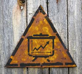 Flipchart Icon on Rusty Warning Sign.